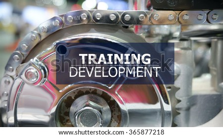 TRAINING DEVELOPMENT on the Mechanism of Metal Cogwheels background , innovation concept , business concept, business idea - stock photo