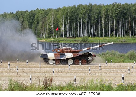 TRAINING GROUND ALABINO, MOSCOW REGION, RUSSIA - JUL 30, 2016: The international army games - 2016. Tank biathlon. T-72 tank on the obstacle course