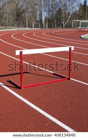Training hurdles in the track. The track is recently renewed.  - stock photo