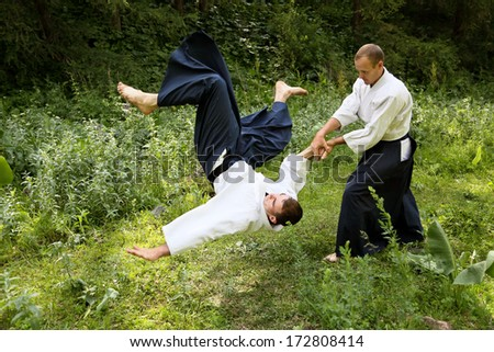 Training martial art Aikido. Outdoors. Summer day - stock photo
