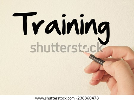 Training text write on wall  - stock photo