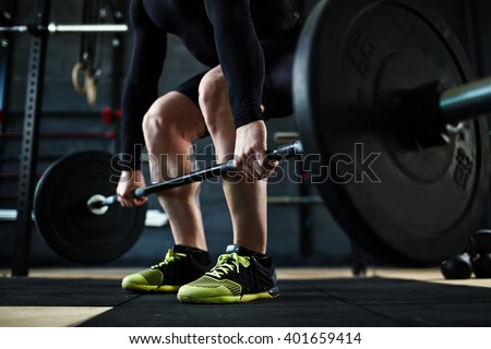 Training with barbell - stock photo