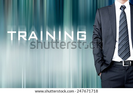 TRAINING word on motion blur abstract background with businessman - stock photo