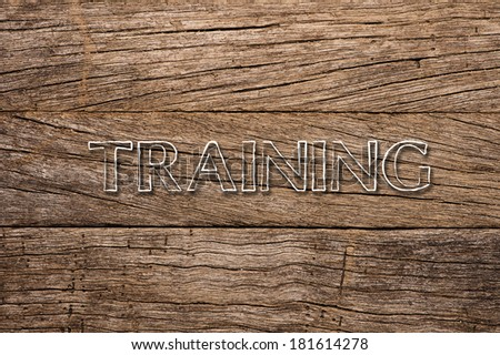 Training written on wooden background
