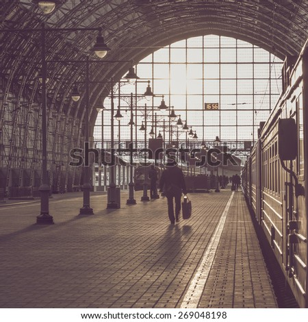 Trains before departure stand at the station at sunset time. - stock photo