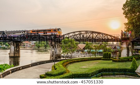 Trains for travel running on the old bridge over the River Kwai Yai is a historical attractions during World War 2 the famous of Kanchanaburi Province in Thailand, 16:9 wide screen - stock photo