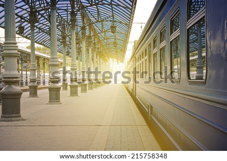 Trains stand at the station at sunrise time. - stock photo