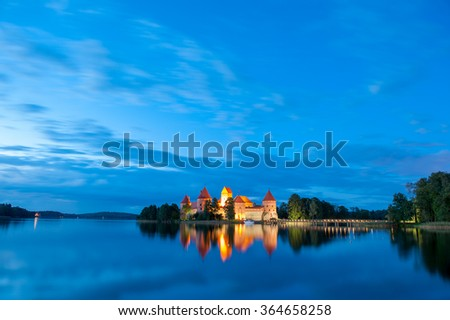 Trakai Castle at night - Island castle in Trakai isd one of the most popular touristic destinations in Lithuania, houses a museum and a cultural center. - stock photo