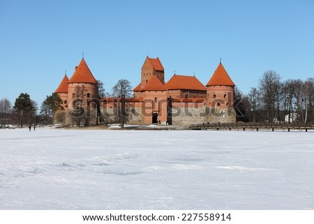 Trakai castle in Lithuania with frozen lake - stock photo