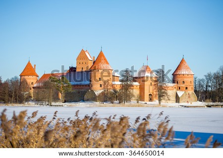 Trakai Castle in winter - Island castle in Trakai is one of the most popular tourist destinations in Lithuania, houses a museum and a cultural centre. - stock photo