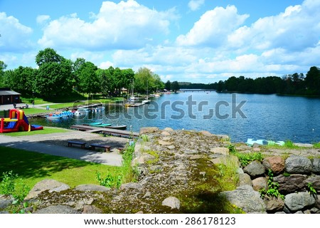 TRAKAI, LITHUANIA - MAY 31: Galves lake and boats in the lake view on May 31, 2015, Trakai, Lithuania.