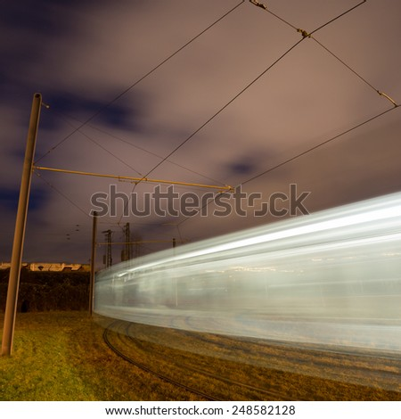 tram at night with motion blur  - stock photo