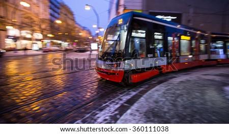 Tram in motion - panning effect at night in Prague - stock photo