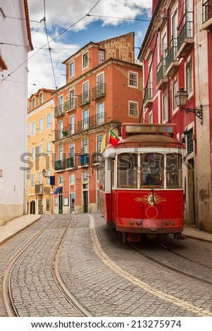 tram on narrow street of Alfama, Lisbon, Portugal  - stock photo