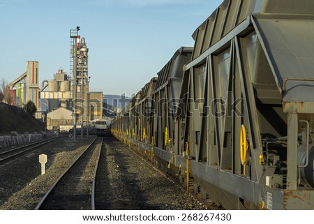 tram waiting to get into the cement factory - stock photo