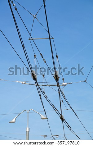 tram wires with blue sky background