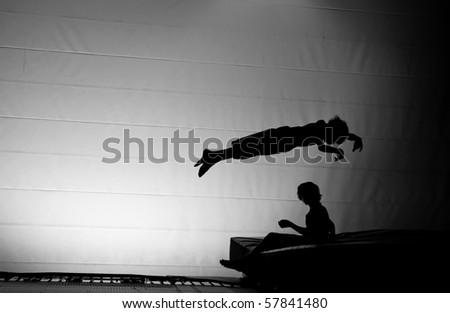 trampoline silhouette - stock photo