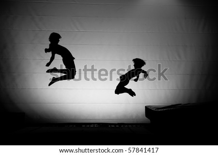 trampoline silhouette friends - stock photo