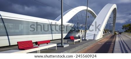Tramway crossing a bridge, Lyon, France.  - stock photo