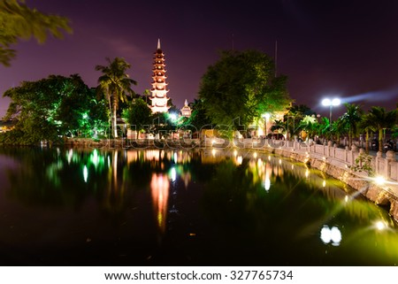 Tran Quoc pagoda at night view in Hanoi. This pagoda is located on a small island near the southeastern shore of West Lake. This is the oldest Buddhist temple in Hanoi, Vietnam - stock photo