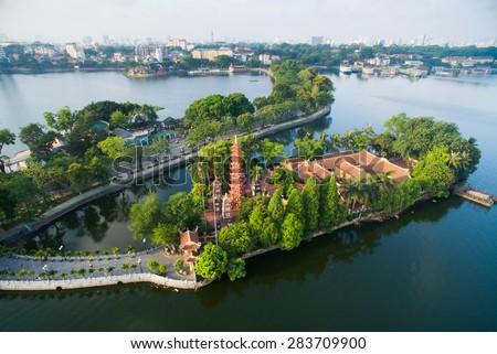 Tran Quoc pagoda in early morning in Hanoi, Vietnam - stock photo