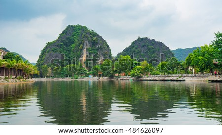Trang An, Vietnam - May 23 2016 : People living in Trang An, Tam Coc, Ninh Binh, Viet nam. It's is UNESCO World Heritage Site, renowned for its boat cave tours. It's Halong Bay on land of Vietnam