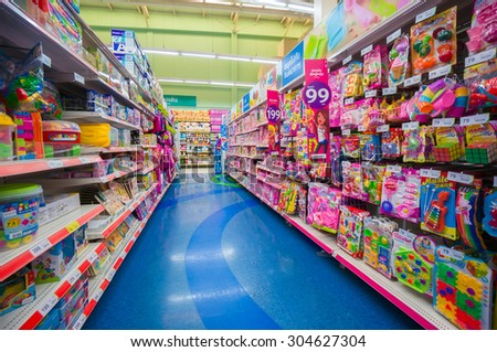 Trang, 25 June 2014: Rows of shelves with toys in Tesko Lotus mall at Trang, Trang province, Thailand.