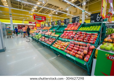 Trang, 25 june 2015: Rows with fruits and vegetables tables and boxes in Tesco Lotus supermarket in Trang, Trang province, Thailand.  Tesco Lotus is a largest hypermarket chain in Thailand. - stock photo