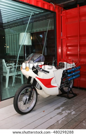 Trang, Thailand - September 5, 2016: Japanese style racing Motorcycle for visitors to take photo at Cinta Garden. The Motorcycle look like motorcycle from Japanese Kamen Rider Comic Tv Series.