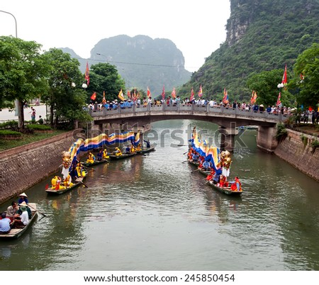 TRANGAN ECO-TOURIST COMPLEX, VIETNAM - NOVEMBER 26, 2014 - Tourists travelling by boat along a stream. This is a UNESCO site and very famous for its beauty of caves, temples & natural beauty. - stock photo