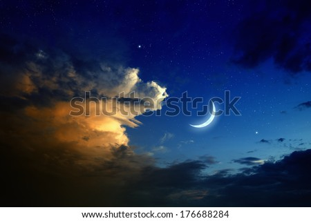 Tranquil background - beautiful romantic sunset, big glowing cloud, moon and bright stars in dark blue sky. Elements of this image furnished by NASA - stock photo