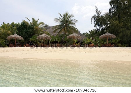 Tranquil beach of an idyllic holiday resort in the Maldives. - stock photo