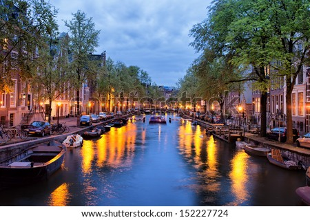 Tranquil evening by the canal in the city of Amsterdam, Netherlands, North Holland. - stock photo