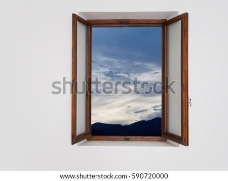 Tranquil evening scene and sky through open window..