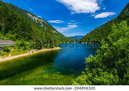 Tranquil lake in the high mountains Alps Austria - stock photo