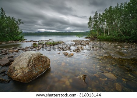 Tranquil lake in the Northern wilderness of Norway - stock photo