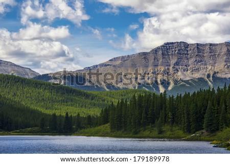 Tranquil lake in the pristine Alberta wilderness. - stock photo