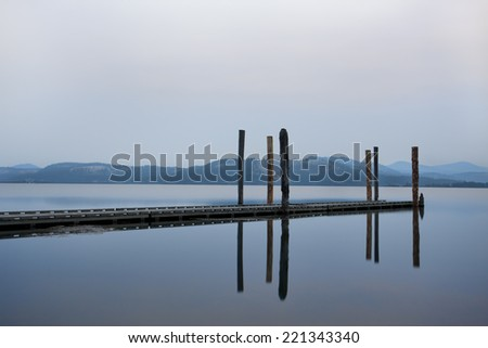Tranquil morning by the water on the calm Chatcolet Lake in north Idaho. - stock photo
