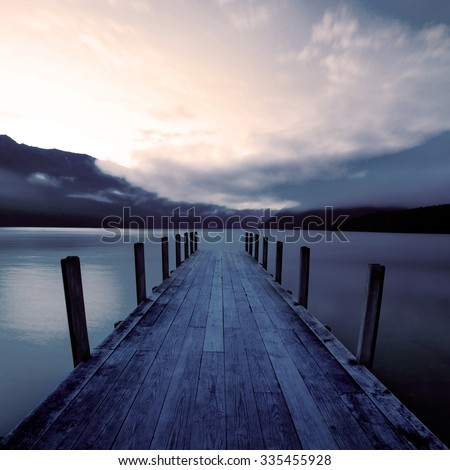 Tranquil Peaceful Lake at Sunrise Nature Concept - stock photo