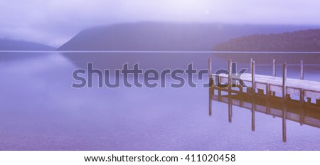 Tranquil peaceful lake with jetty , New Zealand. - stock photo