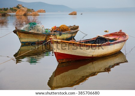 Tranquil scene in Lake Bafa near Bodrum, Mugla, the fishing boats and reflections in the water. - stock photo