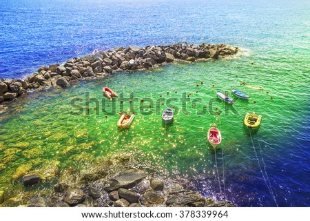 Tranquil scene on the beach, in Cinque terre - Riomaggiore ,most popular attraction ,for the many tourists, in entire world. Creative image with colored filters. - stock photo