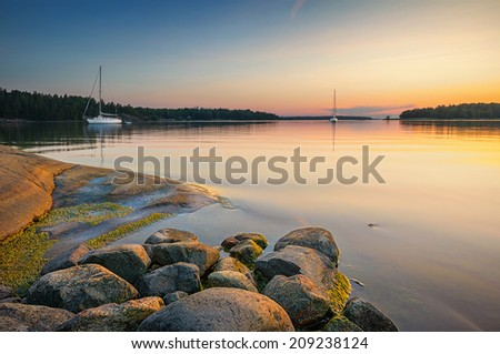 Tranquil scene with sailboats moored for the night, Sweden - stock photo