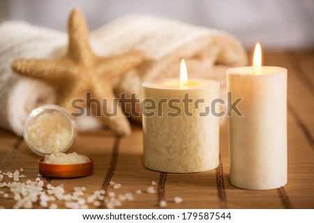 Tranquil scene with Towel, bath salt, Candle, and sea-star.