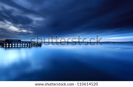 Tranquil sea at the mouth of weymouth harbour in dorset england - stock photo