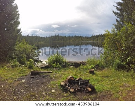 Tranquil setting fire pit alongside Campbell Lake, Harrison Hot Springs, British Columbia - stock photo