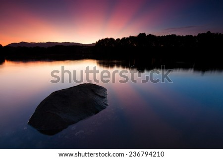 Tranquil sunrise at a lake in Sabah, East Malaysia, Borneo - stock photo