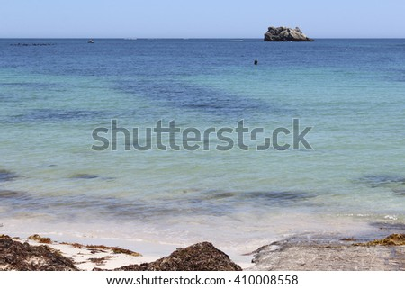 Tranquil view  of the isolated seaweed covered   beach  and tranquil Indian Ocean at remote  Hamelin Bay  a popular fishing location in South Western Australia in early summer . - stock photo