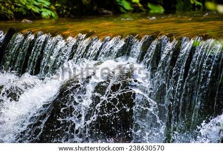 Tranquil waterfall - stock photo