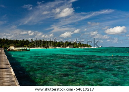 Tranquil waters of a Maldivian island beach - stock photo